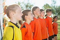 Young female soccer players lined up.