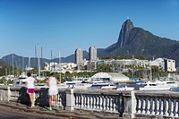 People jogging with Christ the Redeemer statue in background, Urca, Rio de Janeiro, Brazil, South America
