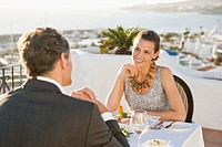 Couple having dinner in outdoor restaurant