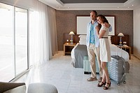 Couple arriving in hotel room
