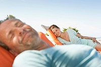 Couple relaxing in sunlight