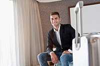 Businessman sitting in hotel room