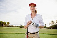 Portrait of woman on golf course