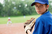 Young baseball pitcher looking back