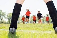 Girls soccer team running on the field