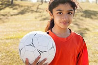 Girl soccer player holding soccerball
