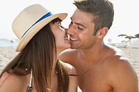 Young couple kissing on beach (thumbnail)
