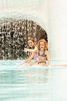 Two girls 6_9 playing in swimming pool
