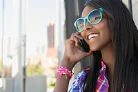 African American teenage girl talking on smart phone