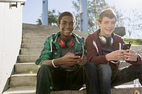 Teenage boys sitting on steps at skate_park