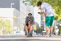 Teens having fun downtown with skateboard