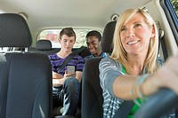 Mom driving with teenage boys in backseat