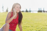 Young adult woman on smart phone in the park