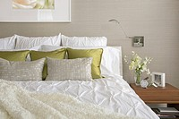 Contemporary bedroom with textured bedding and throw pillows (thumbnail)