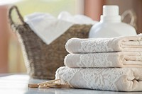 Folded towels with wicker basket and softener
