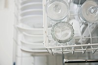 View from above of clean dishes in dishwasher