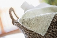 Close_up of clean towel in wicker basket