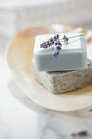 Close_up of guest soaps in soap dish with lavender sprig