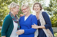 Mother laughing with her adult daughters