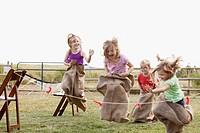 Cousins competing in potato sack race (thumbnail)