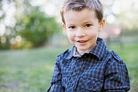 Portrait of four year old boy in plaid shirt