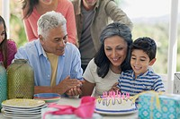 Family excited about birthday cake