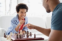 Father and son challenging each other in chess game