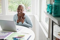 Middle_aged woman with hands over heart during online chat