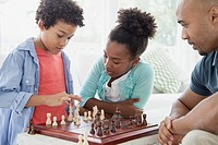 Brother and sister playing a chess game