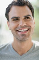 Attractive mid_adult Latin American man smiling
