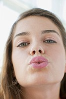 Pretty mid_adult woman with lips pursed