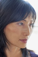 Profile of middle_aged Asian woman with serious look