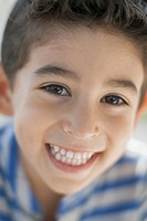 Close_up portrait of young boy with a big smile