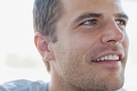 Close_up of handsome mid_adult man with stubble.
