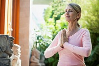 Middle_aged woman in yoga pose