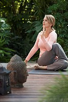 Middle_aged woman sitting in yoga pose