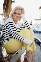 Portrait of senior woman sitting on sailboat