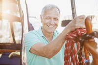 Portrait of senior man on sailboat.