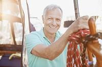 Portrait of senior man on sailboat.