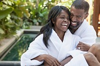 African American couple cudding at outdoor spa