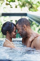 Couple getting close in hot tub