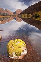 Mountains reflected in Lochan Urr in Glen Etive, Highlands, Scotland, United Kingdom, Europe