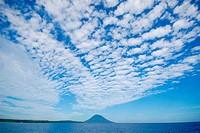 vulcano Manado Tua with altocumulus, Bunaken island, Indonesia