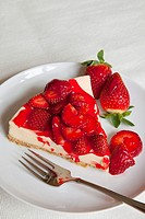Strawberry topped Cheesecake on a round plate