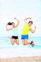 Fitness couple jumping fun