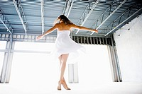 Woman dancing in warehouse