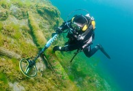 diver with the metal detector looks for a treasure under water, lake Baikal, Siberia, Russia, Eurasia