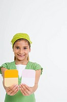 Girl Holding Paint Samples