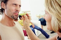 Woman Feeding Man a Slice of Lime