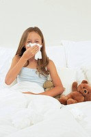 Girl sick in bed